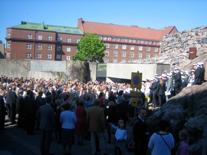 The graduating children and parents waiting to get inside the church.