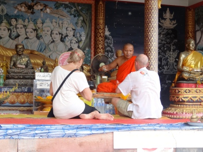 The monk giving out blessing